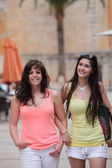 Closed Female Friends Strolling at the City Street — Stock Photo