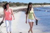 Women at the Beach Holding their Flip Flops — Stock Photo