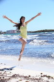 Happy Woman in Jump Shot at the Beach — Foto de Stock