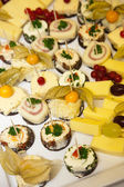 Variety of Appetizers on Cheese Platter — Stock Photo