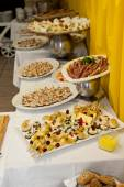 Assorted Appetizing Prepared Foods on White Table — Stock Photo