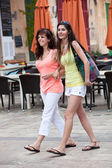 Female Friends Walking at the Street — Stock Photo
