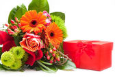 Bouquet of Fresh Flowers and Red Gift Box — Stock Photo