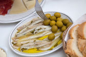 Fresh Fish Meat on White Plate with Olives — Stock Photo