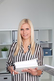 Blond Businesswoman Casually Dressed in Office — Stock Photo