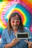 Hippie man pointing towards a blank blackboard — Stock Photo