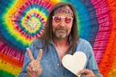 Hippie middle-aged man making the victory sign — Stock Photo