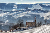 Small church and wintry hills. — Stock Photo