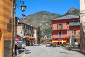 Street among colorful houses in Tende, France. — Stock Photo