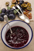 Fresh plum jam in an enamel bowl — Stok fotoğraf