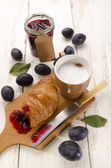 Breakfast with croissant and cafe au lait — Stockfoto