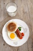 Sausage and fried egg on a plate — Stock Photo