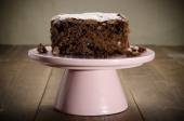 Brownie on a pink cakestand — Stock Photo