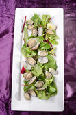 Steamed clams with salad on a plate — Stock Photo