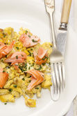 Scrambled eggs with salmon and dill — Stock Photo