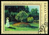 Vintage  postage stamp. Lady in Garden, by Claude Monet. — Stock Photo