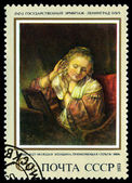 Vintage  postage stamp.   Woman Truing on Earrings, by Rembrandt — Stock Photo
