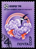 Vintage  postage stamp. EXPO 74. Swallow over Clouds. — Stock Photo