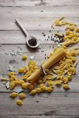 Cooking concept. Uncooked italian pasta: vermicelli, spaghetti with twine on wooden background — Stock Photo