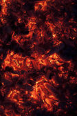 Vertical shot of glowing embers in hot red color — Stock Photo