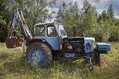 Abandoned wheeled tractor — Stock Photo