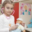 Caucasian little girl playing doctor — Stock Photo #72651645