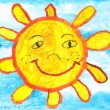 Child's drawing of a funny sun over blue sky — Stock Photo #74786517
