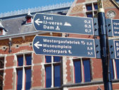 Sign with directions in the center of Amsterdam — Stock Photo