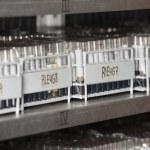 Racks Of Test Tubes On Shelf — Stock Photo #54503011