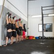 People Doing Handstands At Cross Training Box — Stock Photo #54504513