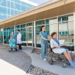 Medical Team With Patients On Wheelchairs At Hospital Courtyard — Stock Photo #54504561