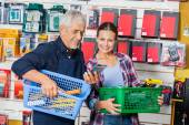 Worker Showing Product To Customer In Hardware Shop — Stock Photo
