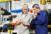 Customer And Vender Discussing Over Packed Tool — Stock Photo