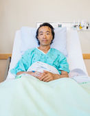 Male Patient Reclining On Bed In Hospital — Stok fotoğraf