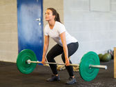 Woman Lifting Barbell — Stok fotoğraf