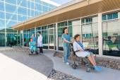 Medical Team With Patients On Wheelchairs At Hospital Courtyard — Photo