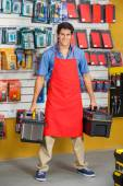 Confident Salesman Holding Toolboxes In Store — Stock Photo