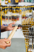 Salesman Holding Hammer In Hardware Store — Stock Photo