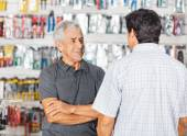 Man Conserving With Son In Hardware Store — Stock Photo