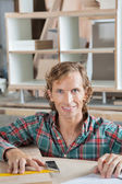 Confident Carpenter Smiling At Workbench — Stock Photo