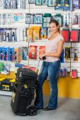 Woman Holding Tool Case In Hardware Store — Stock Photo