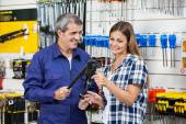 Vendor Showing Pliers To Female Customer — Stock Photo