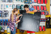 Customer And Salesman Checking Wrench Size Using Board — Stock Photo