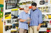 Father And Son Checking Checklist In Hardware Store — Stock Photo