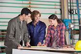 Carpenters Discussing Over Blueprint At Table — Stock Photo
