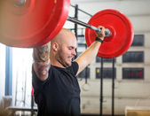 Athlete Exercising With Barbell At Gym — Stock Photo