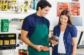 Worker Accepting Payment From Woman In Hardware Store — Foto Stock