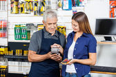 Woman Paying Through Smartphone In Hardware Store — Stockfoto