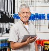 Senior Customer Holding Tablet Computer In Hardware Store — Stock Photo