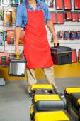Salesman Carrying Toolboxes In Store — Stock Photo